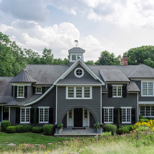 Inspiration for a huge victorian gray three-story wood gable roof remodel in New York