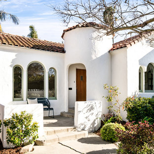 Mediterranean White One Story Gable Roof Idea In Los Angeles With A Tile  Roof