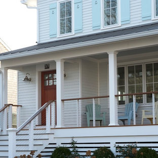 Mid-sized beach style white two-story wood exterior home idea in New York with a metal roof