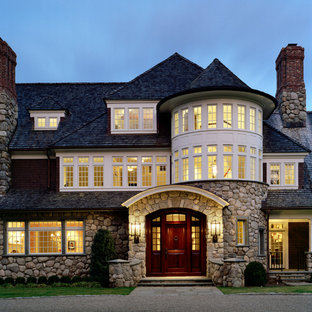 Traditional three-story stone exterior home idea in New York