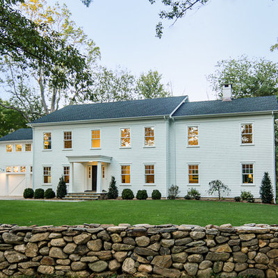 Example of a large country white two-story wood exterior home design in New York
