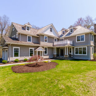 Large transitional gray two-story wood exterior home photo in New York