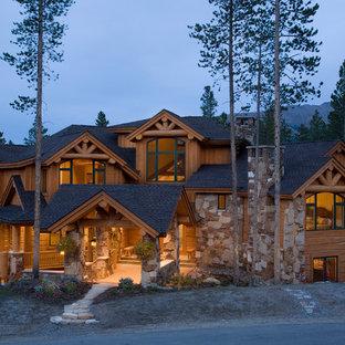 Huge elegant brown three-story stone exterior home photo in Denver