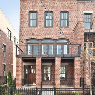 Urban red three-story brick exterior home photo in Atlanta