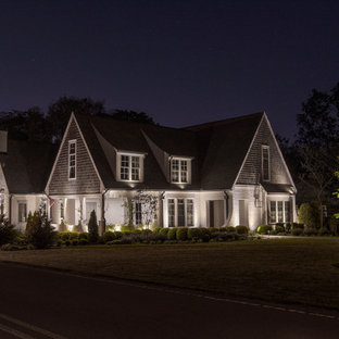 Design ideas for a large contemporary white house exterior in Nashville with a gable roof and a shingle roof.