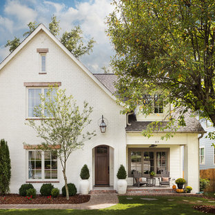 White Brick Home with Welcoming Gas Lantern & Sitting Area