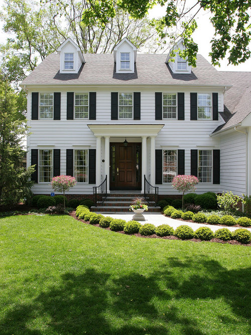 example of a mid sized classic white two story gable roof design in chicago