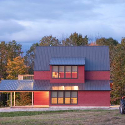 Farmhouse red two-story wood exterior home idea in Portland Maine with a metal roof