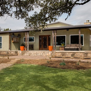 Inspiration for a mid-sized craftsman green one-story stucco exterior home remodel in Austin
