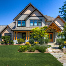 Contemporary Exterior by Kettle River Timberworks Ltd.