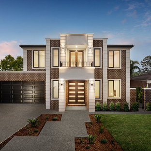 Inspiration for a transitional two-storey brick brown house exterior in Melbourne with a flat roof.