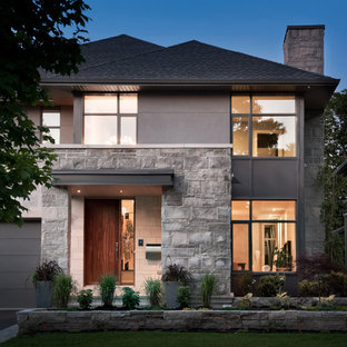 Contemporary stone exterior home idea in Ottawa with a hip roof