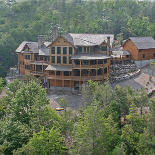 Inspiration for a huge rustic brown two-story wood gable roof remodel in Other
