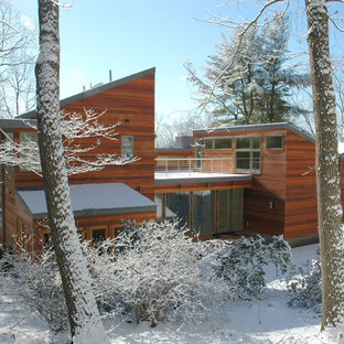 Inspiration for a large contemporary brown two-story wood exterior home remodel in Boston
