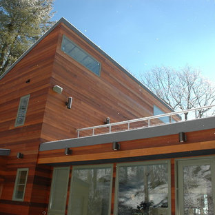 Large contemporary brown two-story wood exterior home idea in Boston