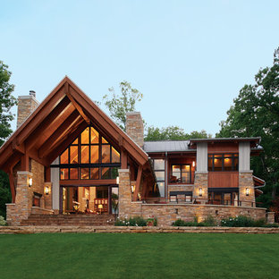 Example of a mountain style brown two-story mixed siding gable roof design in Charlotte with a metal roof
