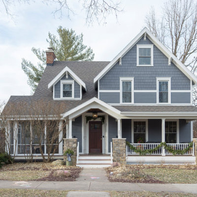 Mid-sized transitional gray two-story vinyl exterior home idea in Other with a shingle roof