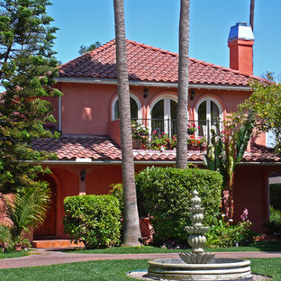 Example of a tuscan pink exterior home design in Los Angeles