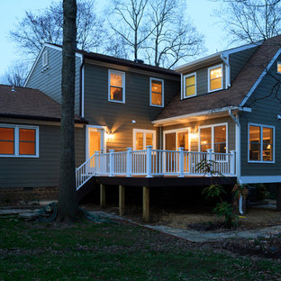 Large elegant gray two-story wood exterior home photo in DC Metro with a shingle roof