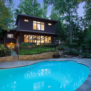Example of a huge 1960s brown split-level wood house exterior design in DC Metro