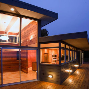 Idee per la facciata di una casa moderna con rivestimento in legno