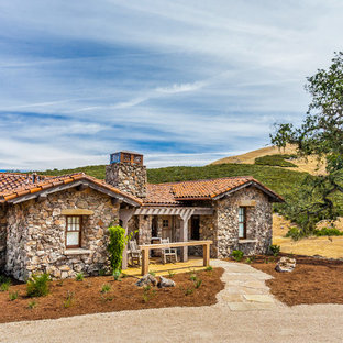Photo of a medium sized rustic one floor exterior in San Francisco with stone cladding.