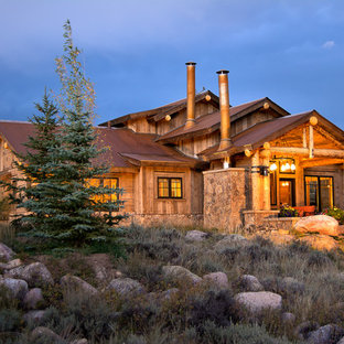 Inspiration for a rustic wood exterior home remodel in Denver with a metal roof