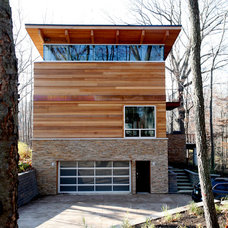 Modern Exterior by Duket Architects Planners
