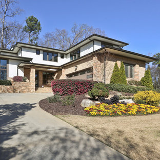 Inspiration for a large transitional beige two-story mixed siding flat roof remodel in Atlanta