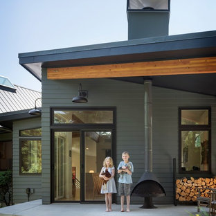 Mid-sized transitional gray split-level concrete fiberboard exterior home photo in Seattle