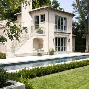 Inspiration for a mediterranean two-story exterior home remodel in Los Angeles