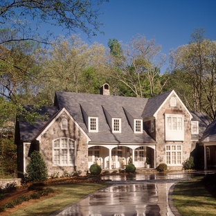 Mid-sized traditional beige two-story stone exterior home idea in Atlanta