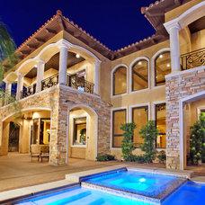 Mediterranean Exterior by Pinnacle Architectural Studio