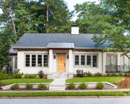 mid sized transitional white one story stucco exterior home idea in atlanta with a
