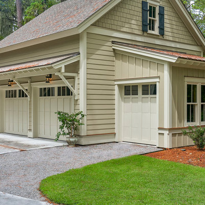 Mid-sized transitional beige two-story concrete fiberboard exterior home idea in Charleston with a shingle roof