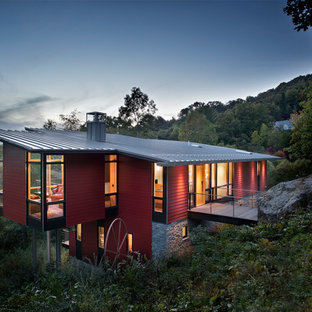 Contemporary red two-story wood house exterior idea in Charlotte with a shed roof and a metal roof