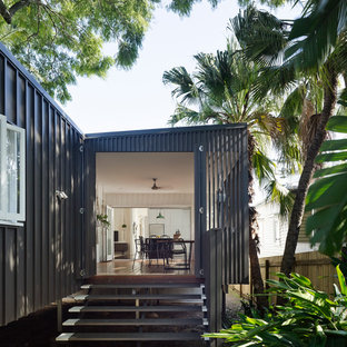 Photo of a contemporary one-storey black exterior in Brisbane with metal siding and a shed roof.