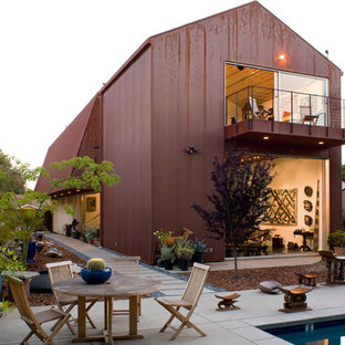 Design ideas for a red modern two floor detached house in Los Angeles with metal cladding, a pitched roof and a metal roof.