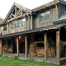 Rustic Exterior by Big Wood Timber Frames, Inc.