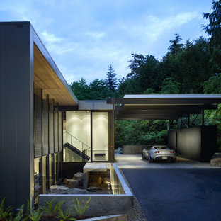 Inspiration for a mid-sized modern black split-level metal flat roof remodel in Seattle