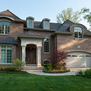 Mid-sized traditional two-story brick exterior home idea in Chicago