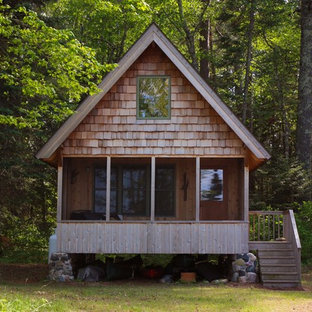 Small mountain style one-story wood gable roof photo in Other