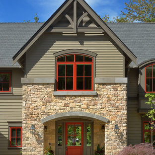 Transitional exterior in Seattle with stone veneer and a gable roof.