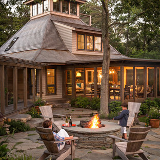 Rustic wood exterior home idea in Boston with a hip roof