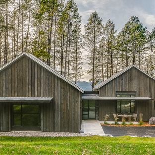 Inspiration for a large rustic brown one-story wood exterior home remodel in Other with a metal roof