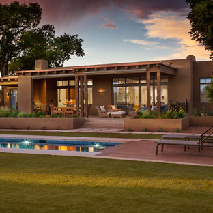 Example of a southwest brown one-story exterior home design in Albuquerque