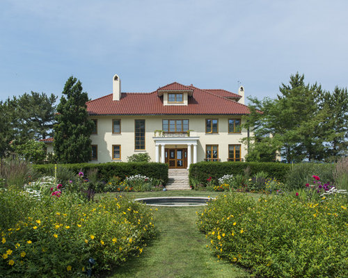 Example Of A Tuscan Beige Three Story Stucco Exterior Home Design In Boston  With A