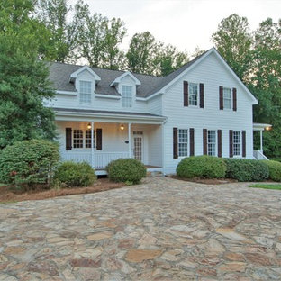 Country white two-story exterior home idea in Other with a shingle roof