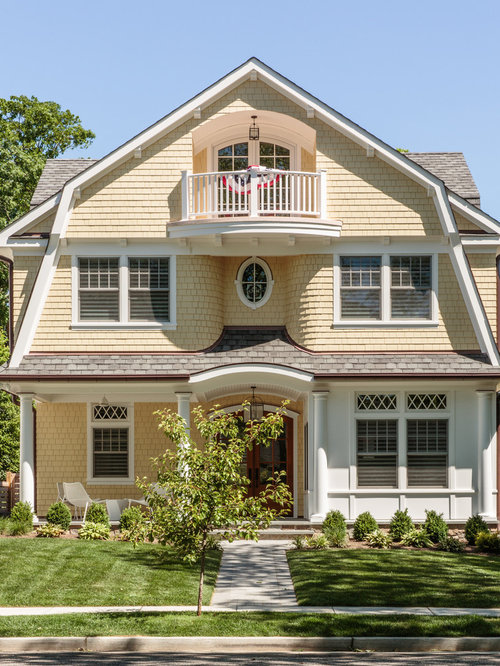 Victorian Yellow Three Story Wood Exterior Home Idea In New York With A Gambrel  Roof