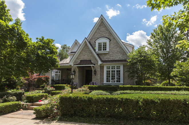 Traditional Exterior by Derrick Architecture